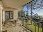 Spacious Balcony with Outdoor Dining at 1872 Beachside Tennis