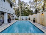 Enjoy a night swim or relaxing in the covered patio at 58 Dune Lane