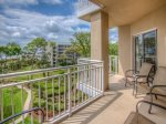 Look out over the landscaped grounds to Atlantic Ocean from the balcony at 5403 Hampton Place