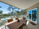 Dine on the Balcony While Enjoying Beautiful Ocean and Pool Views at 2318 Windsor II