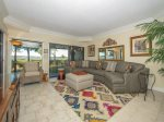 Living Room with Deck Access and Water Views at 1848 Beachside Tennis