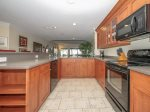 Newly Renovated Kitchen with Water Views at 1848 Beachside Tennis