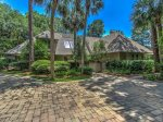 3 Marsh Island Road in Sea Pines has a large driveway and beautiful landscaping
