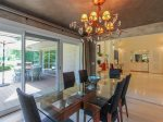 Ten people can fit around the Dining Table at 3 Marsh Island Road in Sea Pines