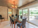 Dining Area at 3 Marsh Island Road has a sliding glass door which opens the area to the outdoors