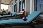 Sun loungers, sofa`s and bar table for pool side relaxation.