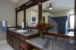Master bathroom with Jacuzzi tub & walk in shower.