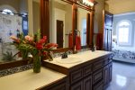 The Lighthouse Room. Bedroom with king bed & ensuite bathroom.