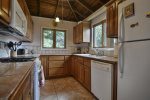 Well equipped kitchen including dishwasher, full oven, microwave, blender, coffee maker.