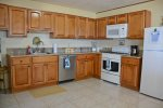 Fully equipped spacious modern kitchen.