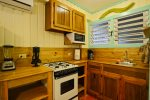 Kitchenette with full size fridge, stove, microwave, blender & coffee maker