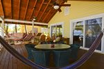 Huge double sliding glass doors open up to the Caribbean