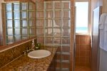 Upstairs en-suite master bathroom with sea and sunset views