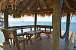 The dock `Palapa` with benches and hammock for kicking back.