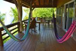 Spacious upper deck with 2 hammocks, 2 rocking chairs plus dining table and chairs.