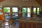 Large granite island with bar stools.
