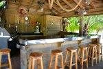 Belly up to the most relaxing beach bar on Roatan.