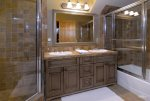 En-suite junior master bathroom with shower and bathtub