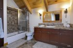 An additional full-sized bathroom off of the family room