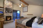 Master Bedroom with King Bed, Gas Fireplace, and Private Covered Deck