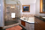 Master Bath has Fantastic Oversized Shower with River Rock Floors