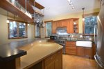 Modern Kitchen with Concrete Countertops and Bamboo Island