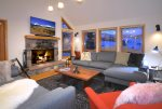 Cozy up to the wood fireplace or watch the Big Game