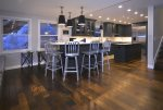 Bar Height Seating around the Marble Countertops