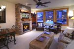 Cozy Up Around the Gas Fireplace with the Family.
