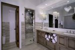 One-of-a-kind master bathroom. Heated towel drawers.