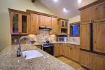 Fully Stocked Kitchen with Granite Counters