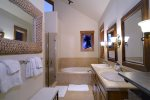 Full size bathroom with tub and shower for King Guest bed