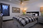 The cozy queen guest bedroom is located on the first floor