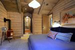 The master bedroom is your dream cabin retreat