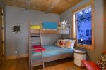 Cute bunk room with a twin over double bed arrangement