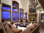 Grand Living with Gas Fireplace and Door to Outside Deck