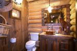Powder bathroom next to the living room