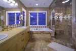 Double vanity, soaking tub, and walk-in shower in the master bathroom