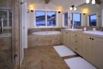 King suite with double vanities, soaking tub, and walk-in shower