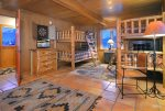 Oversized bunk room with custom log bunkbeds
