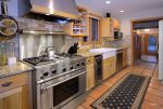 Fully equipped kitchen with gas range and wine fridge