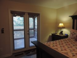 French doors in the Master Bedroom lead to Screened on Back Deck