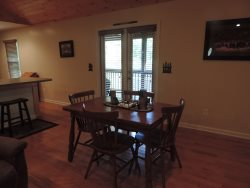 Dining table seats 4 Guest. French Doors lead to Screened in Back deck