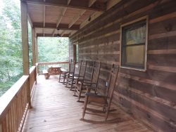 Back Deck off the Kitchen\/Dining room with Rockers and Picnic table.