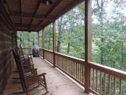 Other angle of the back deck with a Gas BBQ Grill.