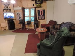 Game Room is downstairs with 2 Recliner Chairs, 4  Bar Stools with a 42