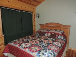 Queen Size Bed in the 2nd Bedroom located upstairs