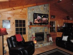 Living room has a Gas Fireplace 2 leather sofas both with recliners on each end
