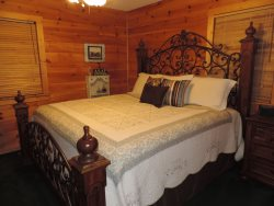 King Size Bed in the Master Bedroom On the main Floor.