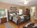 Master Bed Room has a tall King Size Bed with Dresser & Flat screen TV. Located on the main Floor